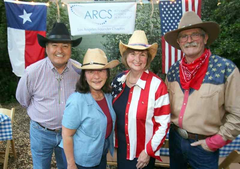 From left: Jerry Gallard, Lynne Brickner, Cheryl Craft and David Lain at a Texas barbecue to benefit ARCS (Achievement Rewards for College Scientists) at the Pasadena home of Craft, president of ARCS. (Photo by James Carbone)